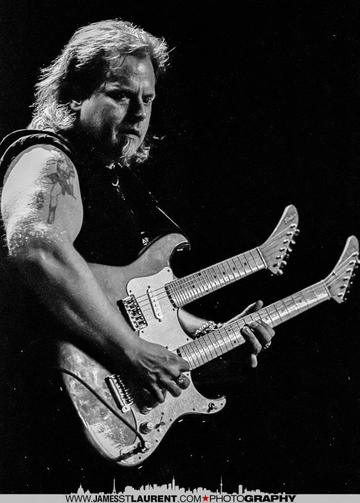 Smokin' Joe Kubek playing a double-neck guitar